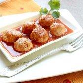 Соковиті їжачки з рисом в сметанно-томатному соусі