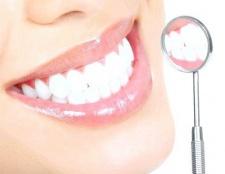 Мертвий чи зуб після видалення нерва?